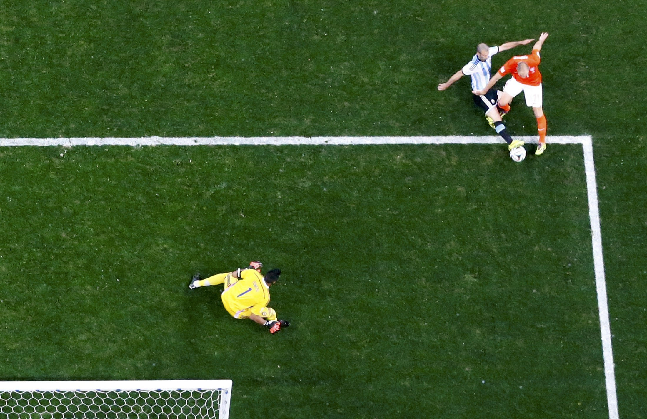 Argentina's Javier Mascherano deflects a shot by Arjen Robben of the Netherlands during their 2014 World Cup semi-finals at the Corinthians arena