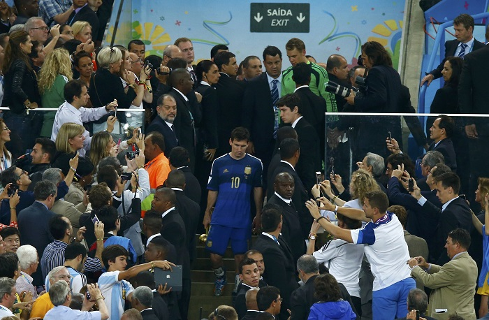 Fans take pictures of Argentina's Lionel Messi after he was awarded the Golden Ball at the end of their 2014 World Cup final against Germany at the Maracana stadium in Rio de Janeiro
